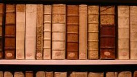 492062_old_books_in_a_shelf