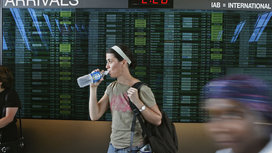 Woman_walking_through_airport