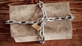 Book-locked-away-in-chains