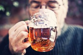 Man_drinking_a_stein_of_beer
