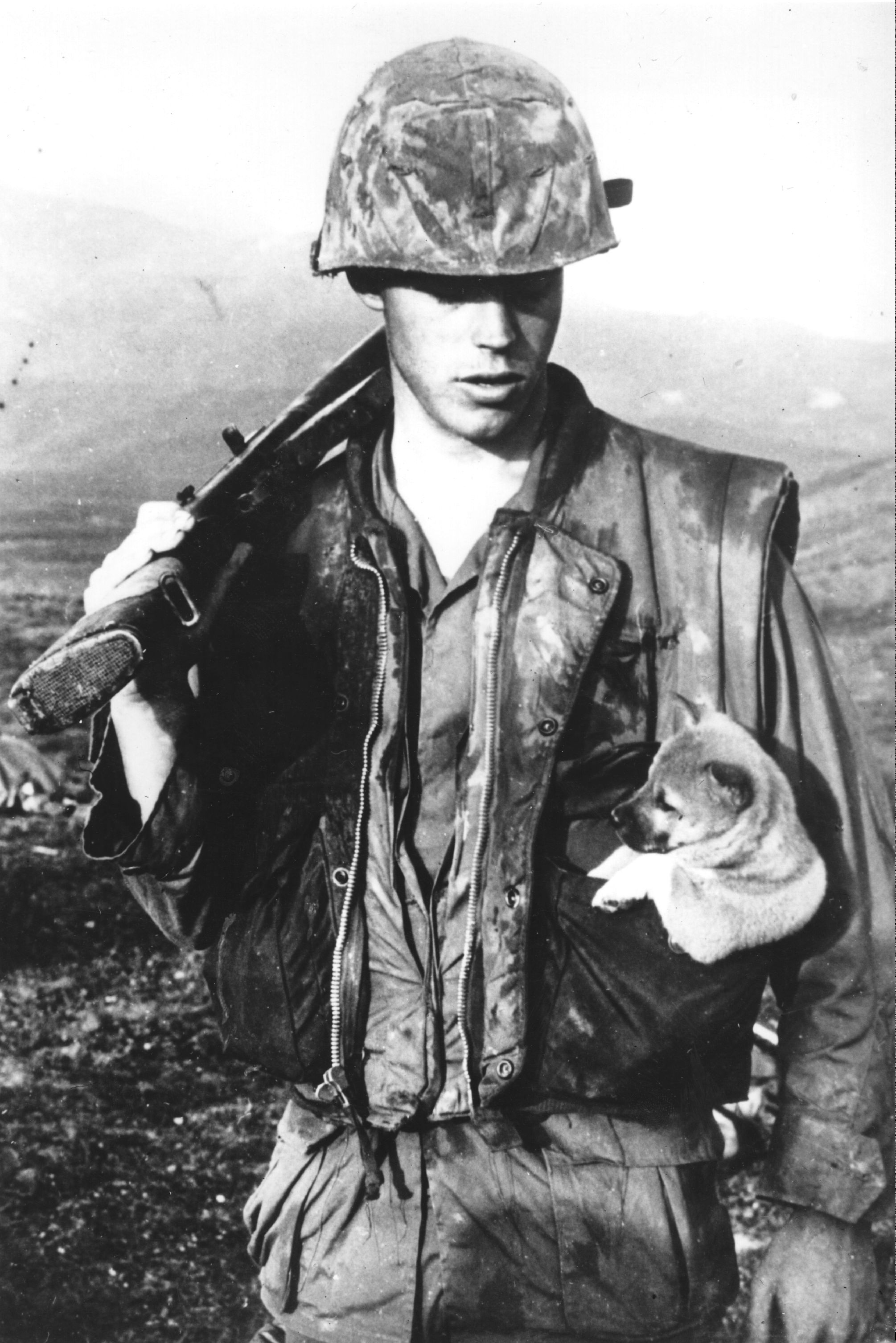 Can any war be just vietnam war in rare photos big think a soldier of the us seventh marines carrying a little puppy in his pocket after rescuing it during an operation south west of da nang in vietnam sciox Image collections
