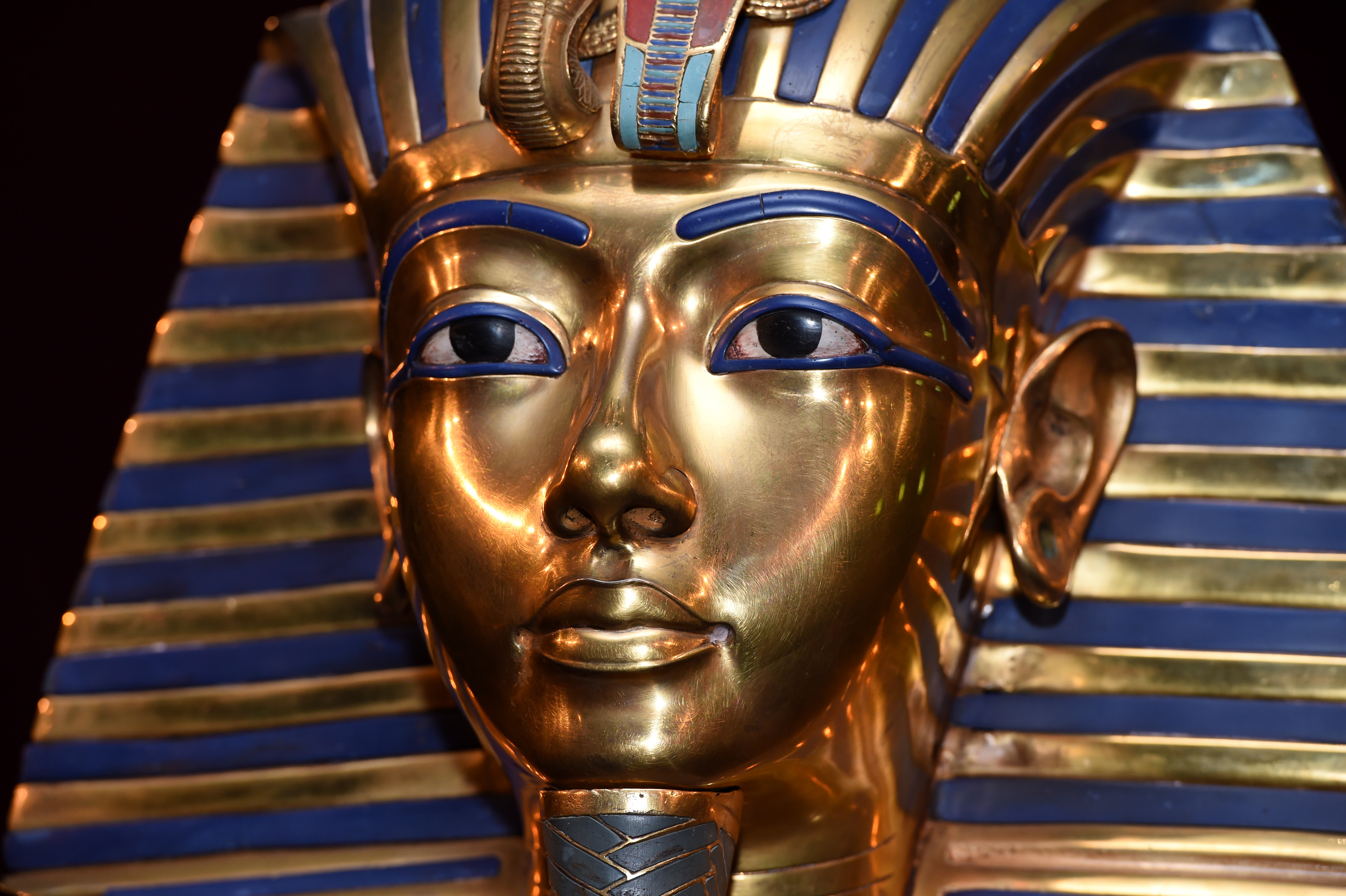 The gold mask of King Tutankhamun is seen alongside a dagger found in the  wrapping of Homework helpers essays term papers