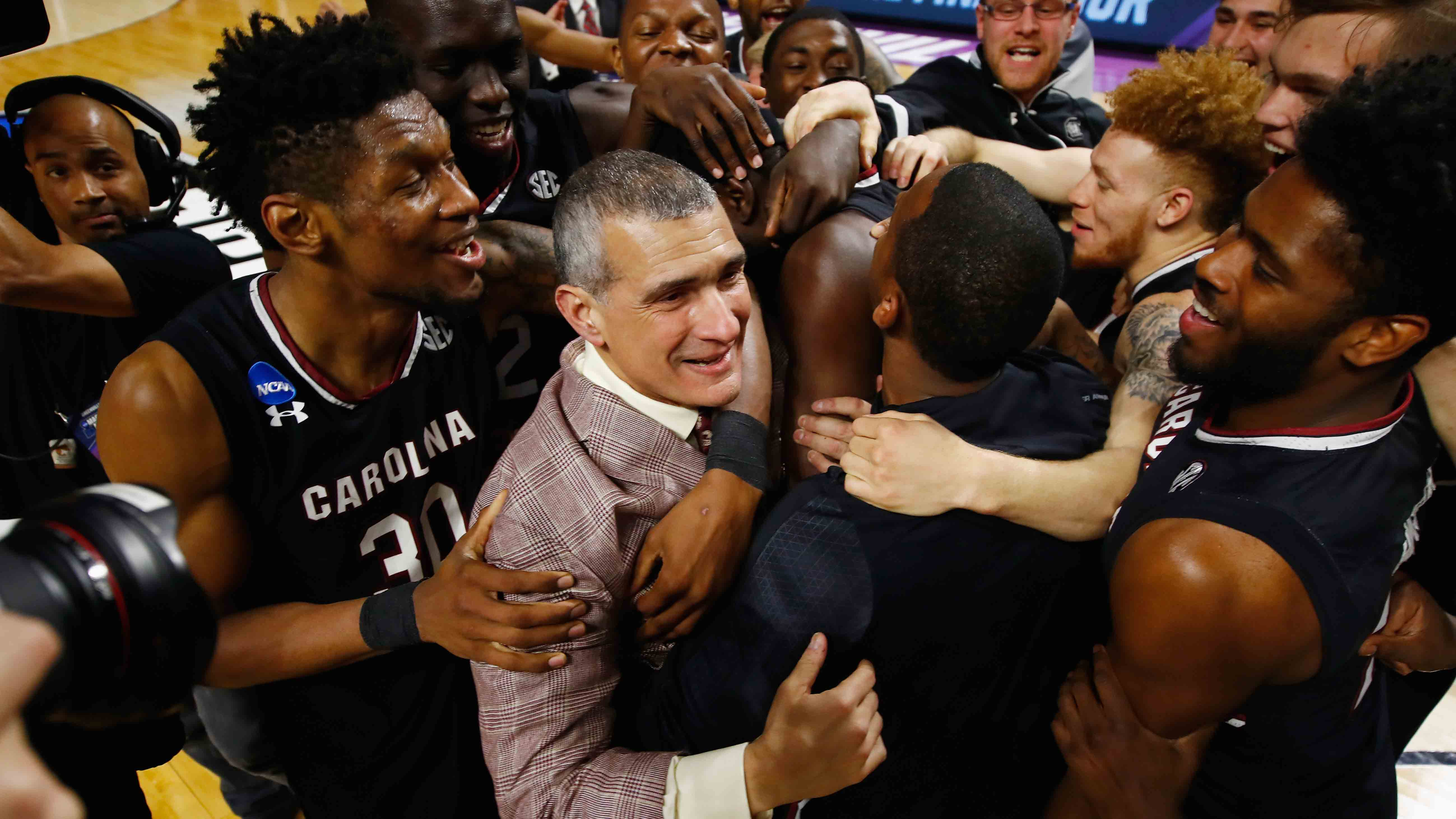 The South Carolina basketball team reacts after defeating Duke in the 2017 NCAA basketball tournament.