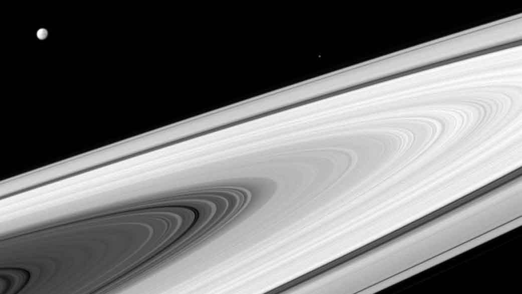 Saturn's main rings, along with its and moons, are much brighter than most stars.
