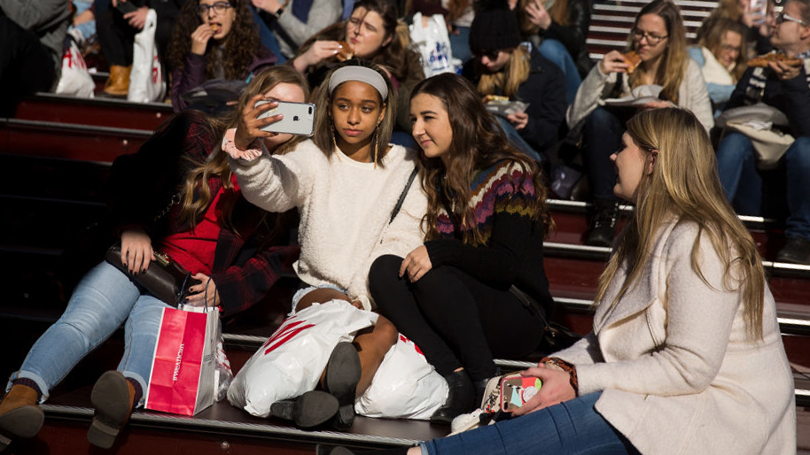 teenagers take a selfie in Times Square, New York City