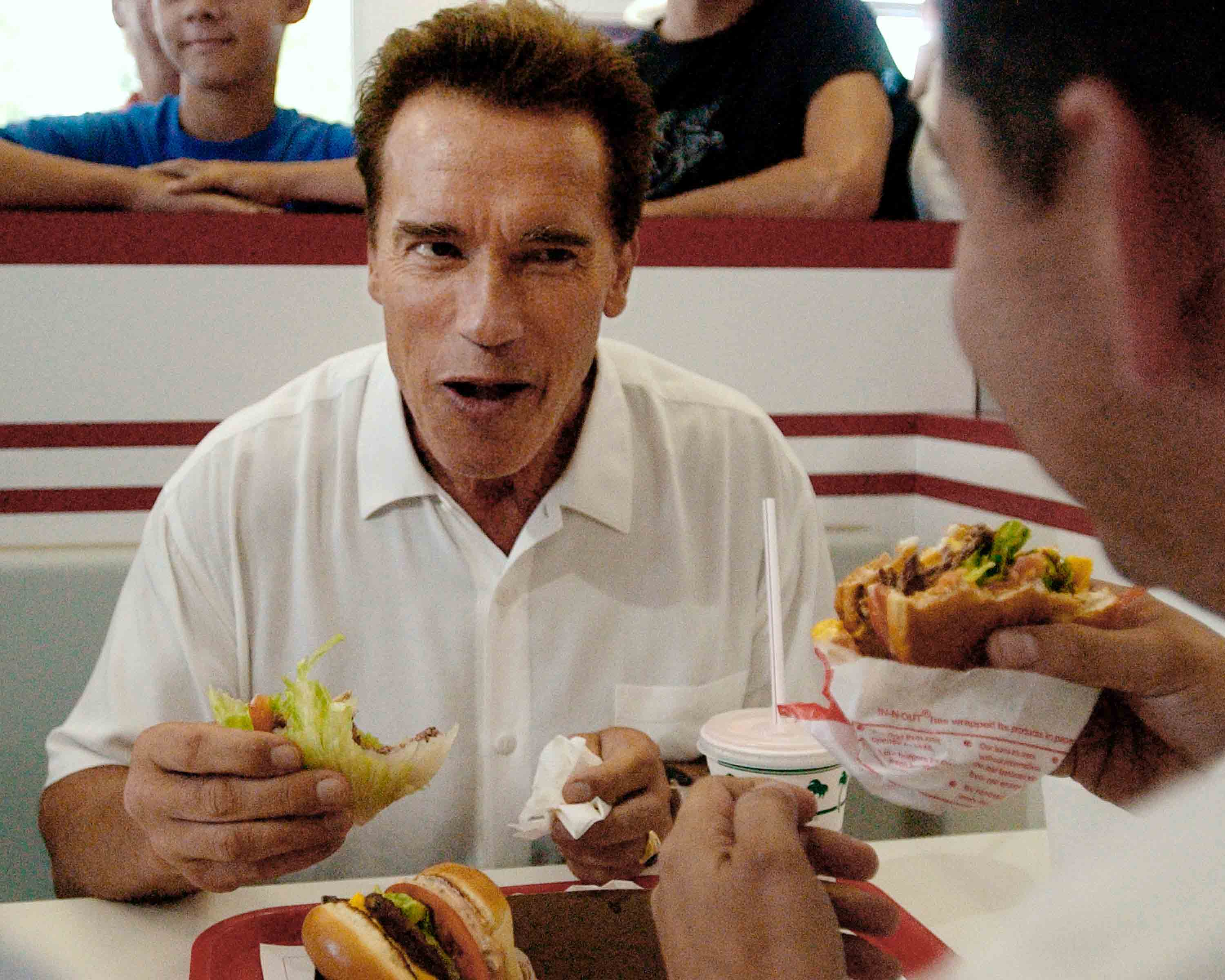 California gubernatorial candidate Arnold Schwarzenegger eats at an 'IN & Out' restaurant